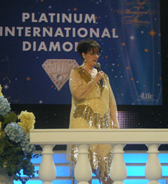 Bonnie giving a speech at the 2009 4Life Convention